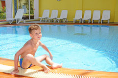 Young boy swimming in the indoor pool Royalty Free Stock Images
