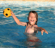 Young boy/swimming pool Stock Image