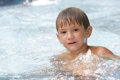 Young boy swimming in pool Royalty Free Stock Images