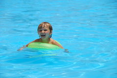 Young Boy in Swimming Pool Royalty Free Stock Images