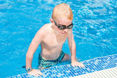 Young boy at swimming pool Stock Photo