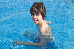 Young Boy is in the Swimming Pool Stock Images
