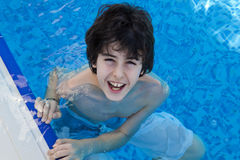 Young Boy is in the Swimming Pool Stock Photos