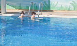 Young Boy is in the Swimming Pool Stock Photography