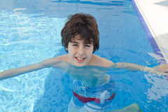 Young Boy is in the Swimming Pool Stock Photo