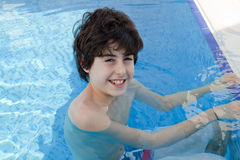 Young Boy is in the Swimming Pool Royalty Free Stock Photos