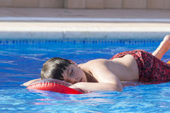Young boy in a swimming pool Stock Photos