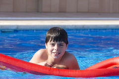 Young boy in a swimming pool Stock Photo