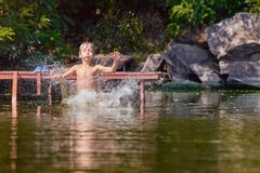 Young boy swimming in the river Stock Image