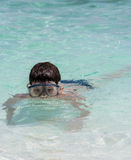 Young boy swimming Stock Images