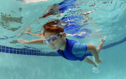 Young boy swimming underwater Royalty Free Stock Photography