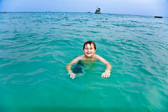 Young boy is swimming in the warm Stock Image