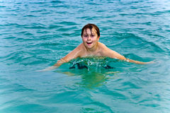 Young boy is swimming in the warm Stock Photography