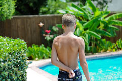 Young boy in swimsuit by pool Royalty Free Stock Images