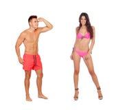 Young boy in swimwear looking at a sexy girl in bikini Stock Photo