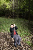 Young boy on the swing Royalty Free Stock Photo