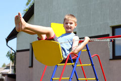 Young boy on swing Royalty Free Stock Photography