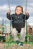Young Boy Swinging Royalty Free Stock Images