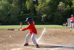 Young boy swinging at baseball. Royalty Free Stock Photo