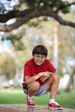 Young boy on table in the park Royalty Free Stock Photography