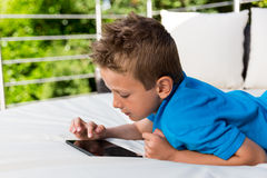 Young boy with a tablet Royalty Free Stock Images