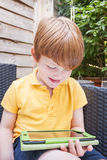 Young boy on tablet Stock Images