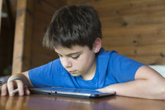 Young boy and a tablet digital royalty free stock photos