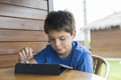 Young boy and a tablet digital royalty free stock image