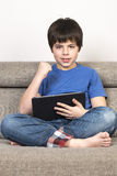 Young boy and a tablet digital stock images
