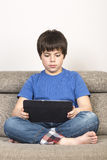 Young boy and a tablet digital royalty free stock images