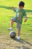 Young boy tackling ball Stock Photos