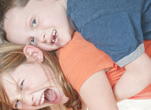 Young boy tackling girl. In fun Stock Photography
