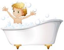 A young boy taking a bath at the bathtub Stock Photos