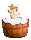 A young boy taking a bath at the big bathtub Royalty Free Stock Image