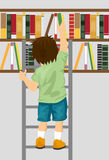 Young boy taking book from shelf with ladder in library Stock Images