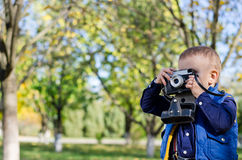 Young boy taking a photograph Royalty Free Stock Photography
