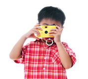 Young boy taking photograph Royalty Free Stock Photo