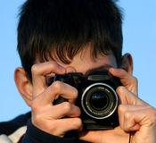 Young boy taking photos Royalty Free Stock Images