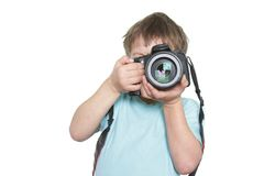 Young boy taking picture Stock Photo