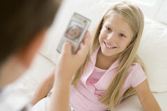 Young boy taking picture of smiling young girl Stock Image