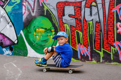 Young boy taking a rest at the skate park Royalty Free Stock Photography