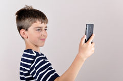 Young boy taking selfie Royalty Free Stock Photo