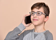 Young boy talking on his smart phone Stock Photos