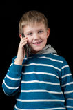 Young boy talking on mobile phone Stock Image