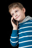 Young boy talking on mobile phone and smiling Stock Photography