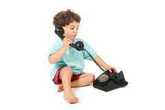 Young boy talking on a retro phone Royalty Free Stock Photography