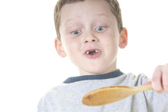 Young boy tasting food Royalty Free Stock Photography