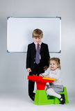 Young boy teaching sister Stock Image