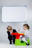 Young boy teaching sister Stock Photography
