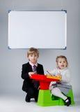 Young boy teaching sister Royalty Free Stock Photos